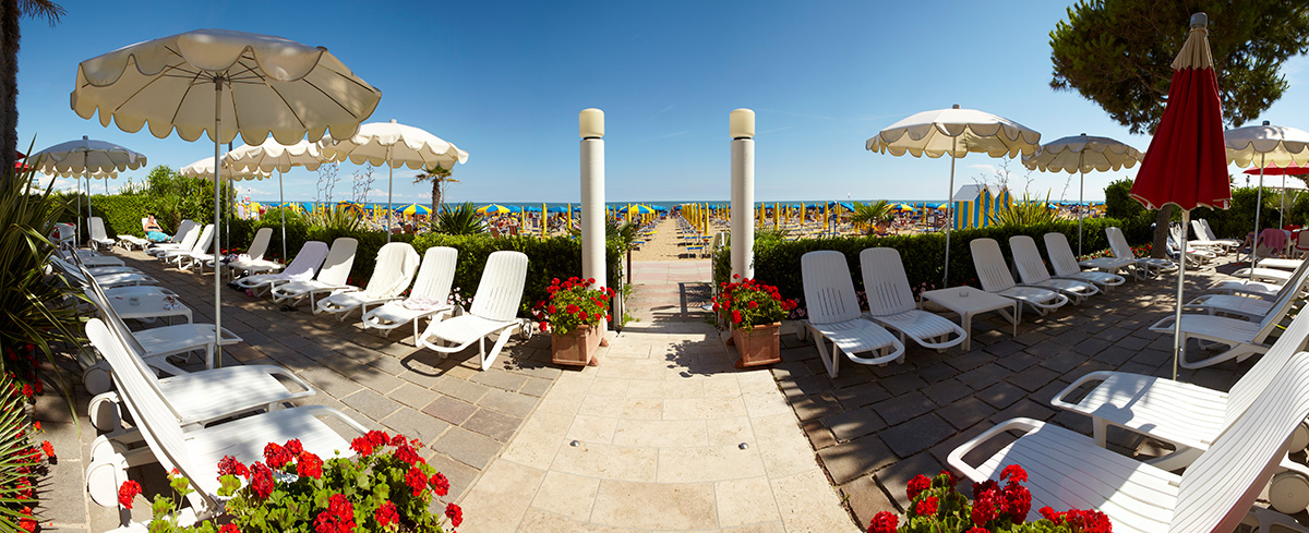 The Termini beach hotels terrace with sun loungers and ombrellas - JESOLO. With direct acces to the private beach.